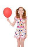 Молодая женщина при красный изолированный воздушный шар стоковое изображение