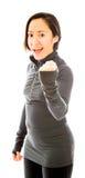 Молодая женщина пробивая воздух и усмехаться Стоковая Фотография