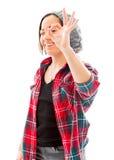 Молодая женщина смотря через пальцы, делая 'одобренный' Стоковая Фотография RF