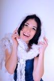 Молодая женщина с белым шумоглушителем Стоковая Фотография