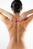 Молодая женщина с болью в ей назад Стоковые Фотографии RF