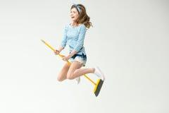 Молодая женщина с веником стоковое изображение rf