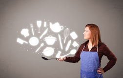Молодая женщина с иконами вспомогательного оборудования кухни Стоковые Изображения RF