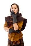Молодая женщина с рукой над ее ртом и ударом Стоковая Фотография RF