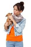 Молодая женщина с собакой стоковые фото