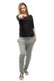 Молодая женщина указывая обвинительный палец Стоковые Изображения RF