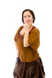 Молодая женщина думая с ее рукой на подбородке Стоковые Изображения RF
