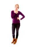 Молодая женщина думая с ее рукой на подбородке Стоковое фото RF
