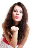 Молодая женщина дуя поцелуй изолированный Стоковая Фотография RF