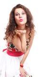 Молодая женщина дуя поцелуй изолированный Стоковые Изображения RF