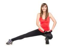Молодая женщина фитнеса протягивая ноги Стоковая Фотография RF