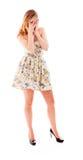 Молодая женщина peeking через руки покрывая сторону Стоковая Фотография RF