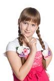 Молодая задумчивая девушка на белой предпосылке Стоковое фото RF