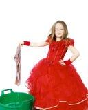 Молодая Золушка одела в красном цвете с пакостной тканью стоковое изображение rf