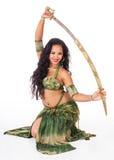 Молодая исполнительница танца живота с шпагой Стоковая Фотография