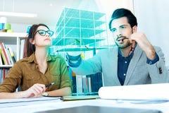 Молодая команда архитектора работая на офисе Стоковое фото RF