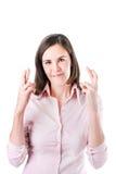 Молодая коммерсантка делая изолированное желание, на белой предпосылке. стоковое изображение