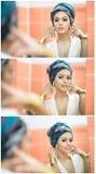 Молодая красивая женщина при тюрбан и золотые аксессуары смотря в большое зеркало Обольстительная дама при серьги представляя, зе Стоковые Фотографии RF
