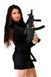 Молодая красивая сексуальная женщина держа личное огнестрельное оружие в руке стоковые изображения rf