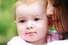 Молодая мать с младенцем стоковые изображения