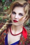 Молодая милая женщина с отрезком провода Стоковая Фотография
