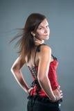 Молодая привлекательная женщина в красном корсете Стоковое Фото
