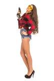 Молодая сексуальная женщина держа сверло конструкции Стоковая Фотография
