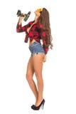 Молодая сексуальная женщина держа сверло конструкции Стоковое Изображение