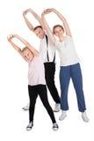 Молодая семья делая протягивающ тренировки Стоковая Фотография RF