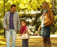 Молодая семья из трех человек Стоковое Изображение