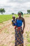 Молодая сенегальская женщина с ее ребенком Стоковое Изображение RF