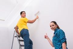 Молодая стена картины пар дома Стоковая Фотография