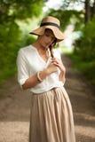 Молодая стильная девушка унылая о что-то Стоковая Фотография