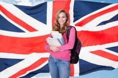 Молодая студентка держа книги стоковое изображение rf