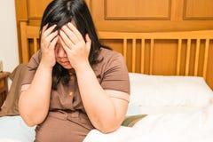 Молодая тайская беременная женщина под стрессом Стоковое Фото