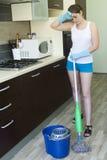 Молодая утомленная девушка с mop и ведром Стоковое Изображение