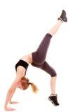 Молодая sporty девушка делая протягивающ изолированную тренировку. Здоровый образ жизни Стоковые Изображения