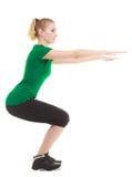 Молодая sporty девушка делая протягивающ изолированную тренировку Стоковые Фото
