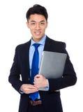 Молодое владение бизнесмена с портативным компьютером Стоковая Фотография RF