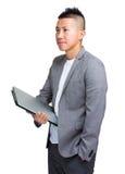 Молодое владение бизнесмена с портативным компьютером Стоковые Фото