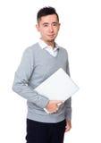 Молодое владение бизнесмена с портативным компьютером Стоковые Изображения RF