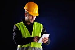 Молодое инженерство с оранжевым шлемом Стоковая Фотография RF