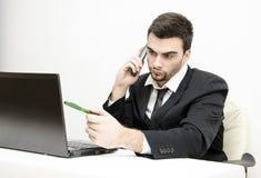 Молодое решение проблем бизнесмена Стоковые Фото