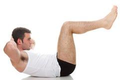 Молодое isolat тренировки парня модели мышцы фитнеса человека спорта моды Стоковое Изображение RF