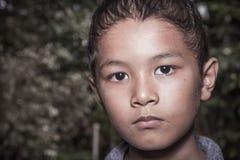 Молодой азиатский мальчик самостоятельно Стоковая Фотография RF