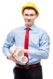 Молодой архитектор в рубашке нося желтую трудную шляпу Стоковое Изображение RF