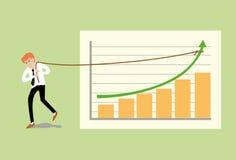 Молодой бизнесмен вытягивая вверх по веревочке на зеленой стрелке Стоковое фото RF