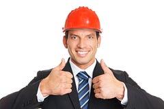 Молодой бизнесмен в шлеме Стоковые Изображения