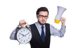 Молодой бизнесмен держа будильник изолированный Стоковые Фото