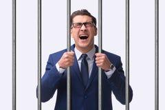 Молодой бизнесмен за барами в тюрьме Стоковое Изображение RF
